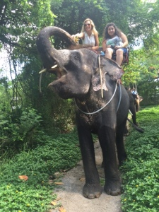 Heather, left, during and elephant tour in Thailand.